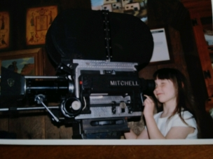 Emily checking the shot on a Vintage Mitchell Camera